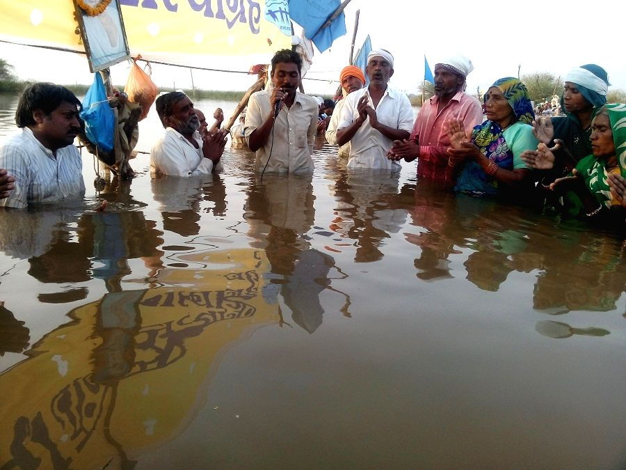 Activists continue their `jal satyagraha` to demand adequate compensation for their submerged land and lowering of water level in the Omkareshwar dam - on Narmada river - for the 24th day in ...