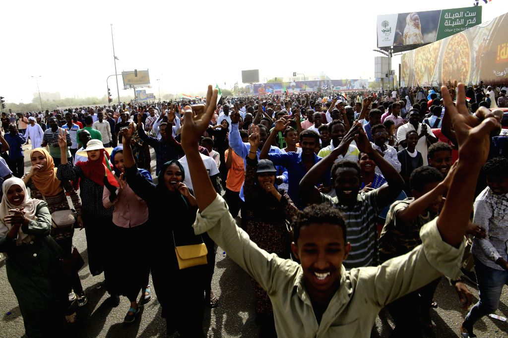 KHARTOUM, April 11, 2019 - Sudanese people celebrate on the street as they are waiting for an important statement from the army in Khartoum, Sudan, April 11, 2019. The Sudanese army has ousted ... - Awad Mohamed Ahmed Ibn Auf