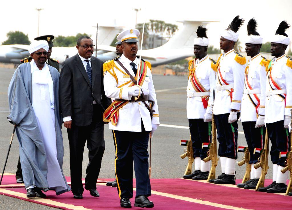 KHARTOUM, Aug. 15, 2017 - Sudanese President Omar al-Bashir (1st L) welcomes Ethiopian Prime Minister Hailemariam Desalegn in Khartoum, Sudan, on Aug. 15, 2017. Ethiopian Prime Minister Hailemariam ... - Hailemariam Desalegn