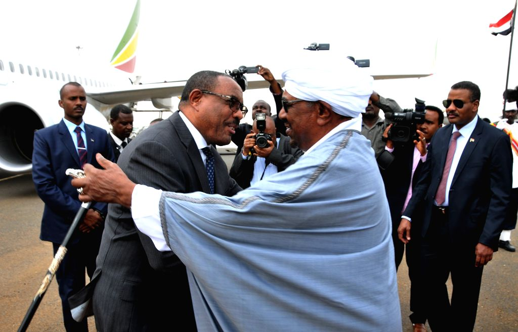 KHARTOUM, Aug. 15, 2017 - Sudanese President Omar al-Bashir (R, Front) greets Ethiopian Prime Minister Hailemariam Desalegn (L, Front) in Khartoum, Sudan, on Aug. 15, 2017. Ethiopian Prime Minister ... - Hailemariam Desalegn