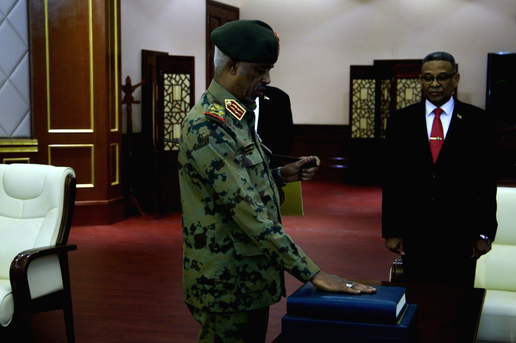 KHARTOUM, Feb. 24, 2019 - Newly-appointed Sudanese first vice president Awad Mohamed Ahmed Ibn Auf (L) takes the constitutional oath at the Presidential Palace in Khartoum, Sudan, Feb. 24, 2019. ...