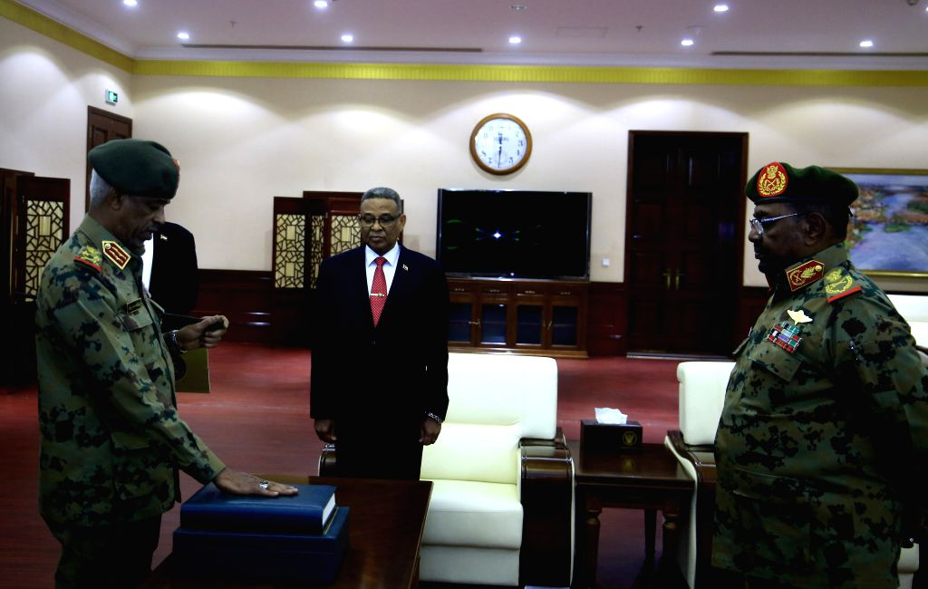 KHARTOUM, Feb. 24, 2019 - Newly-appointed Sudanese first vice president Awad Mohamed Ahmed Ibn Auf (L) takes the constitutional oath at the presence of Sudanese President Omar al-Bashir (R) at the ...