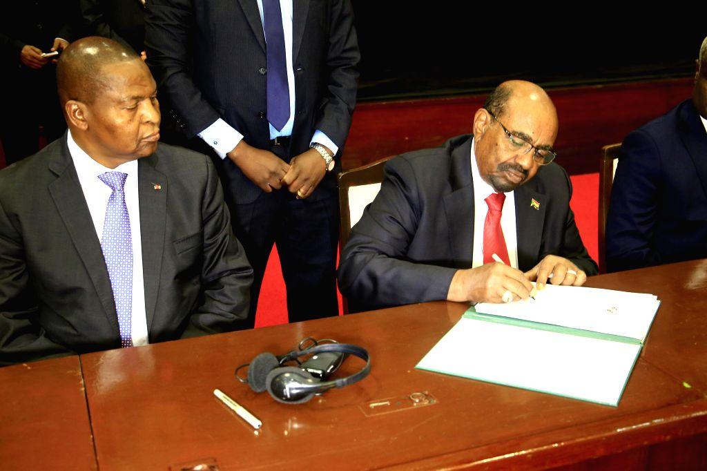 KHARTOUM, Feb. 5, 2019 - Sudanese President Omar al-Bashir (R) signs the document of peace agreement between the conflicting parties of Central Africa Republic (CAR), in Khartoum, Sudan, Feb. 5, ...