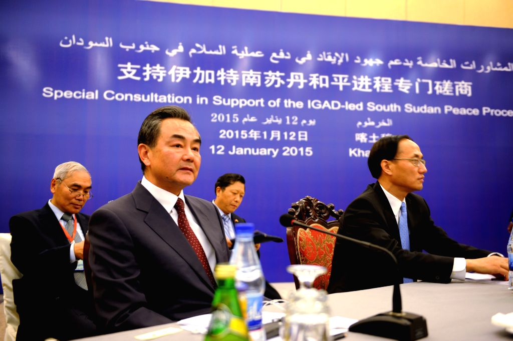 Chinese Foreign Minister Wang Yi (2nd L) attends a consultation with the Inter-Governmental Authority for Development (IGAD) and the South Sudan conflicting ... - Wang Y