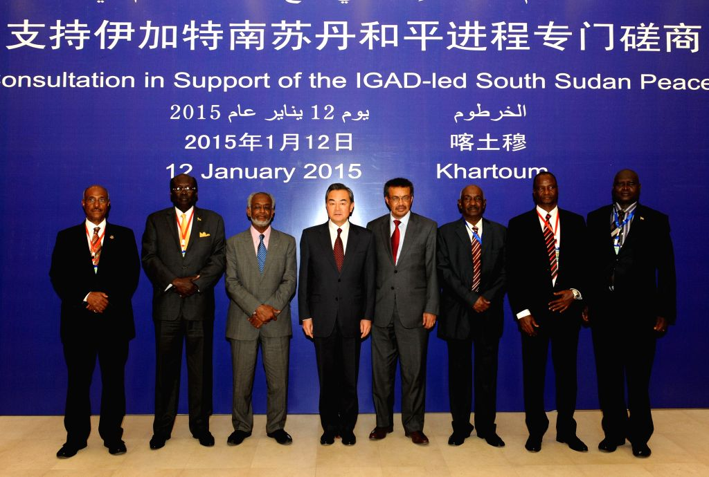 Chinese Foreign Minister Wang Yi (4th L) poses for a group photo with other guests before a consultation with the Inter-Governmental Authority for Development ... - Wang Y