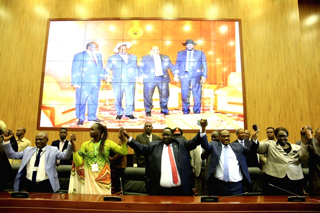 KHARTOUM, July 25, 2018 - Representatives of South Sudan's conflicting parties hold their hands after signing an agreement on power-sharing and governance in Khartoum, Sudan, July 25, 2018. South ...