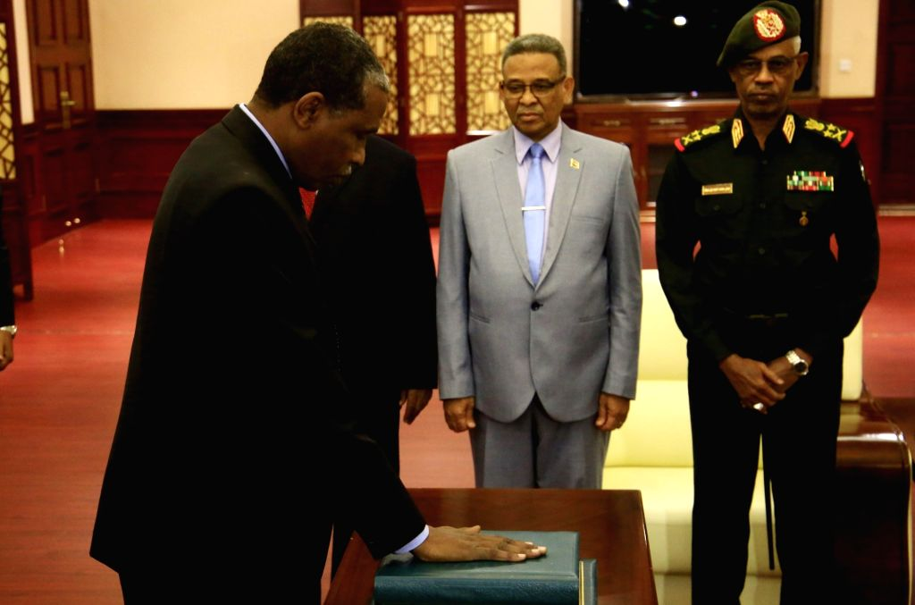 KHARTOUM, March 14, 2019 - Fadul Abdalla Fadul (Front), Sudanese minister of the presidency, takes the constitutional oath before President Omar al-Bashir (not in the picture) in Khartoum, Sudan, on ...