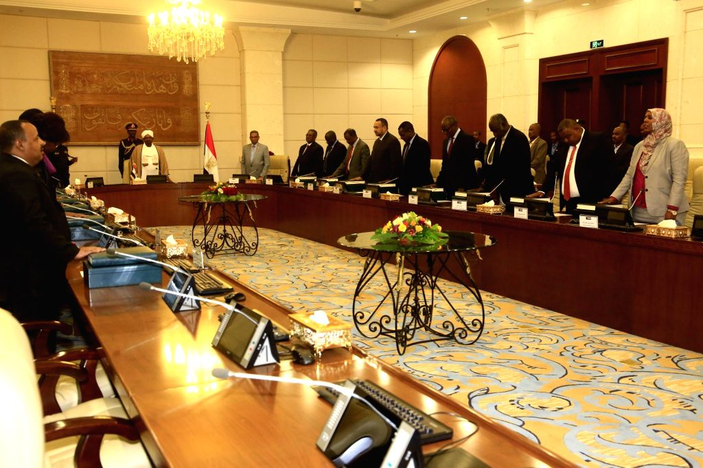 KHARTOUM, March 14, 2019 - Newly-appointed ministers in Sudan's new government take the constitutional oath before President Omar al-Bashir in Khartoum, Sudan, on March 14, 2019.