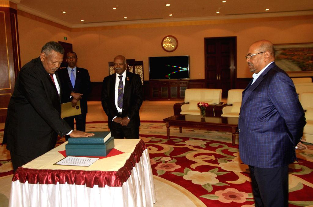 KHARTOUM, March 2, 2017 - Sudan's Prime Minister Bakri Hassan Saleh (L, front) takes oath in front of Sudanese President Omar al-Bashir (R, front) in Khartoum, Sudan, on March 2, 2017. Sudanese First ... - Bakri Hassan Saleh