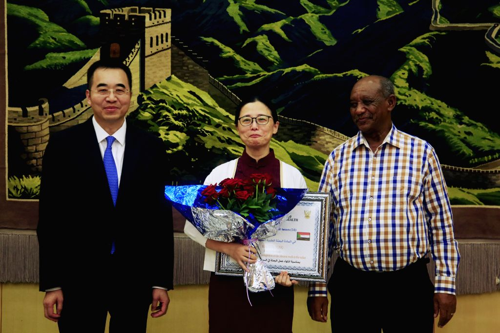 KHARTOUM, Oct. 17, 2019 - Chinese Ambassador to Sudan Ma Xinmin (L), team leader of the 34th Group of Chinese Medical Assistance Team to Sudan Guo Yong (C) and Abdualla Mohammed Ali, representative ...