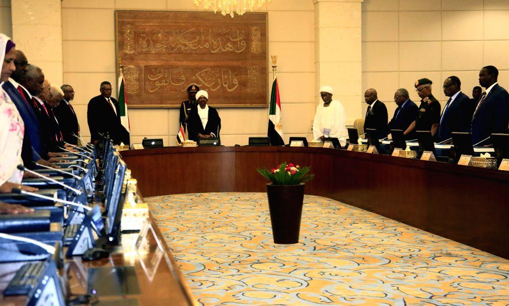 KHARTOUM, Sep. 15, 2018 - Ministers of Sudan's new government take the constitutional oath before Sudanese President Omar al-Bashir in Khartoum, Sudan, Sept. 15, 2018. Sudan's ruling National ...