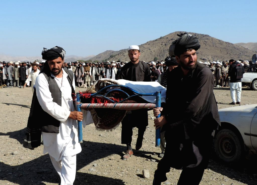 KHOST, Feb. 8 People carry the body of a civilian who was killed by pro-government forces in Ali Sher district of Khost province, Afghanistan, Feb. 8, 2018. At least 11 civilians were ...