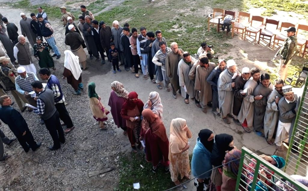 Khrew: Voters queue up at a polling station to cast their votes for the fifth phase of 2019 Lok Sabha elections, at Khrew in Jammu and Kashmir's Pulwama district, on May 6, 2019. (Photo: IANS)