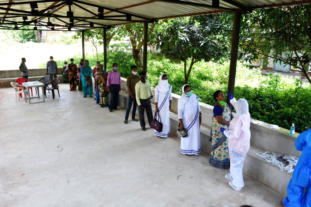 Khunti (Jharkhand): A health worker collects swab samples from villagers and nuns for COVID-19 testing near NH-75 at Torpa Block in Jharkhand's Khunti district about 85 kms from Ranchi on Aug 31, ...
