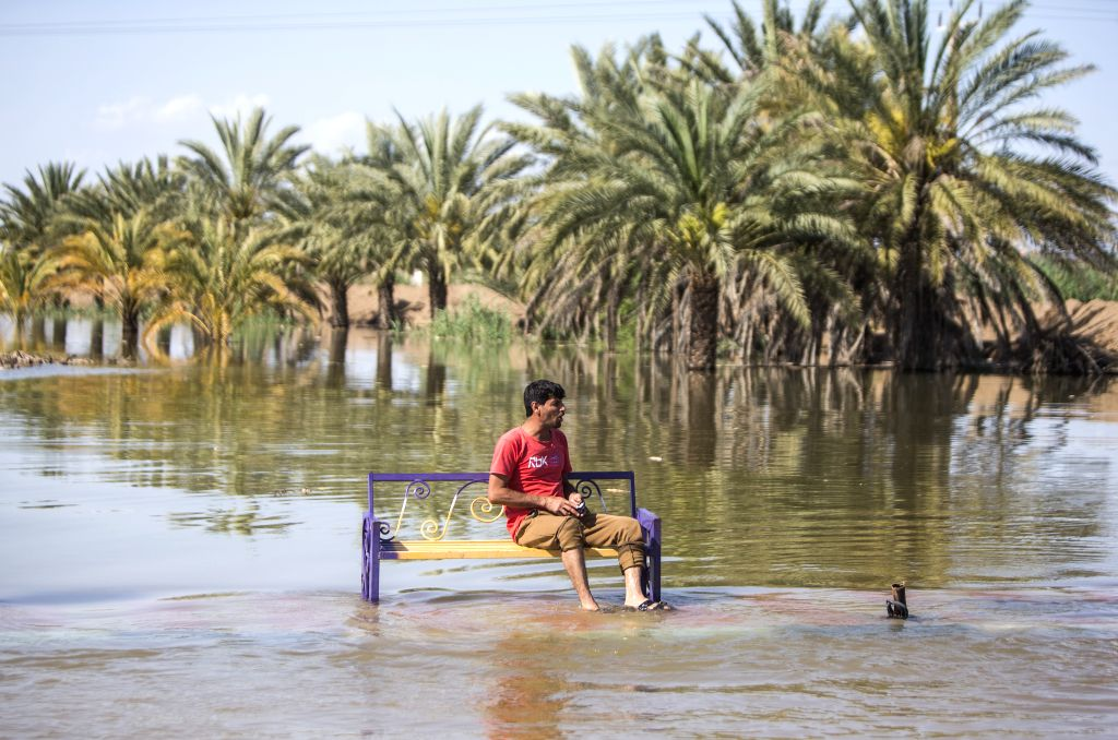 KHUZESTAN, April 9, 2019 - A man sits amid flood water at a village in Khuzestan province, southwestern Iran, April 8, 2019. The unprecedented floods across Iran over the past weeks have claimed the ...