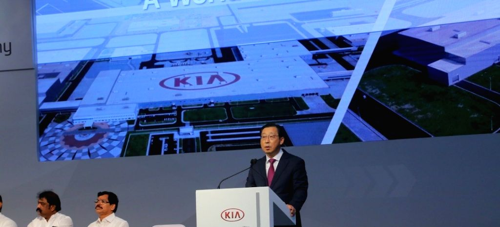 Kia Motors Corporation President and CEO Han-Woo Park addresses during the inauguration ceremony of Kia Motors India (KMI) manufacturing plant in Anantapur district, Andhra Pradesh on Dec ...