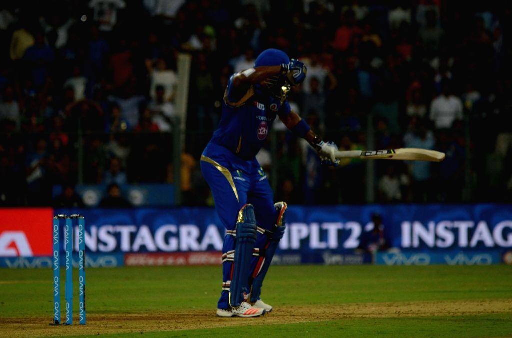 Kieron Pollard of Mumbai Indians celebrates after winning the IPL match against Royal Challengers Bangalore at Wankhede Stadium in Mumbai on April 20, 2016.