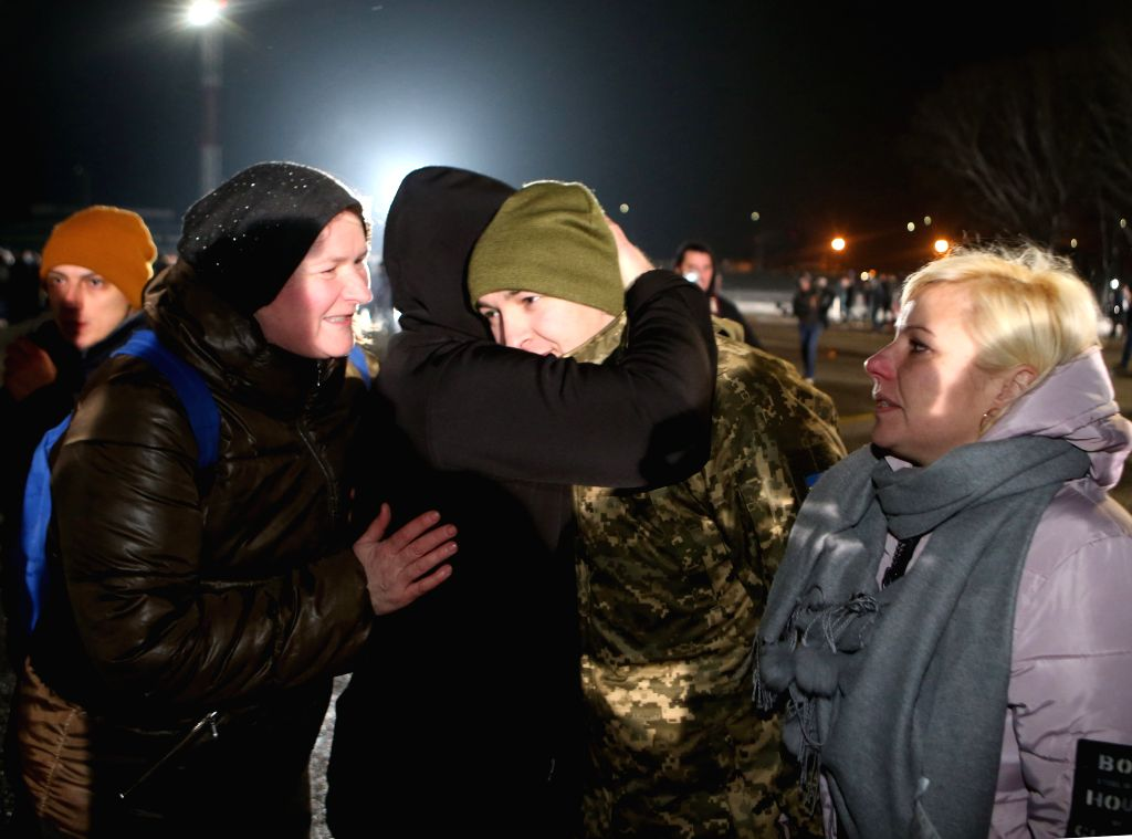 KIEV, Dec. 30, 2019 (Xinhua) -- A released Ukrainian is greeted at the Boryspil International Airport in Kiev, capital of Ukraine, Dec. 29, 2019. The Ukrainian government completed a prisoner swap with rebels in the country's eastern regions and rece