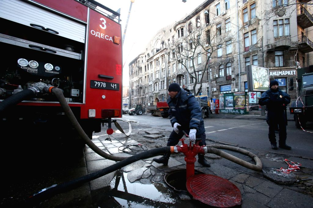 KIEV, Dec. 6, 2019 - Firefighters work at the fire site of the Odessa College of Economics, Law and Hotel and Restaurant Business in Odessa, Ukraine, Dec. 6, 2019. Ukrainian President Volodymyr ...