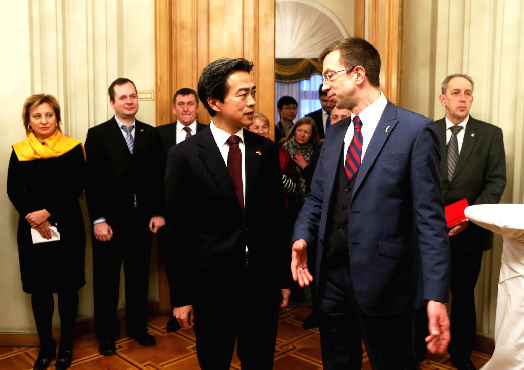KIEV, Jan. 13, 2017 - The State Secretary of the Ukrainian Foreign Ministry Andriy Zayats (R, front) talks with Chinese Ambassador to Ukraine Du Wei (L, front) during the opening ceremony of the ...