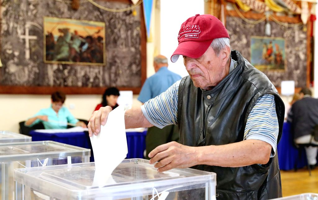KIEV, July 21, 2019 - A man casts his ballot at a polling station in Kiev, Ukraine, July 21, 2019. Ukraine held snap parliamentary elections on Sunday. The elections were originally scheduled for ...