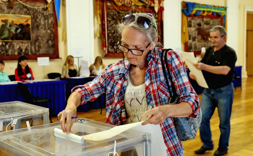 KIEV, July 21, 2019 - A woman casts her ballot at a polling station in Kiev, Ukraine, July 21, 2019. Ukraine held snap parliamentary elections on Sunday. The elections were originally scheduled for ...