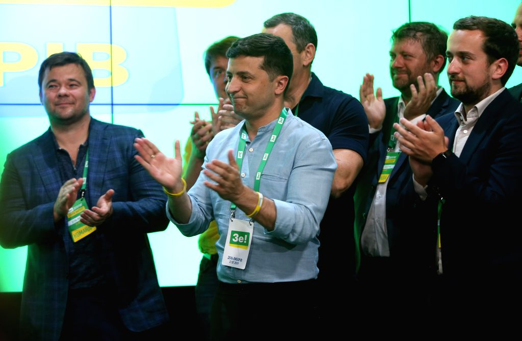 KIEV, July 22, 2019 - Ukrainian President Volodymyr Zelensky (2nd L) applauds for the winning of the Servant of the People party in the nation's snap parliamentary elections in Kiev, Ukraine, on July ...