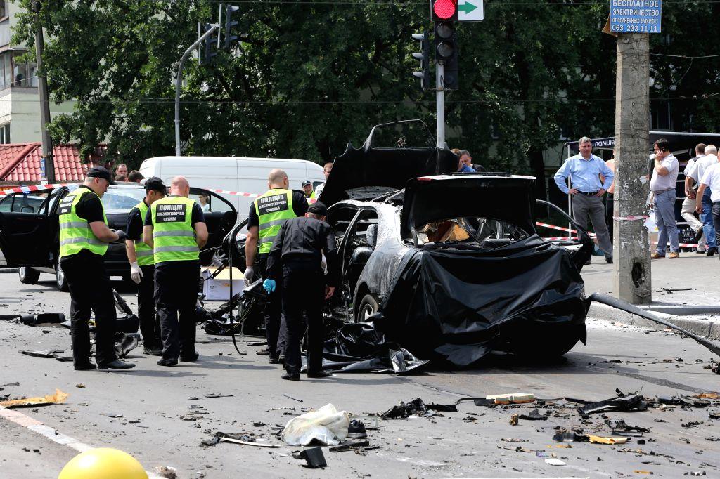 KIEV, June 27, 2017 - Policemen and investigators inspect the site of car blast in Kiev, capital of Ukraine, June 27, 2017. A senior Ukrainian intelligence officer was killed on Tuesday in a car ...