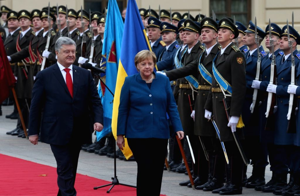 KIEV, Nov. 2, 2018 - Ukrainian President Petro Poroshenko (L, front) welcomes visiting German Chancellor Angela Merkel (R, front) during a ceremony in Kiev, Ukraine, Nov. 1, 2018. Ukrainian President ...