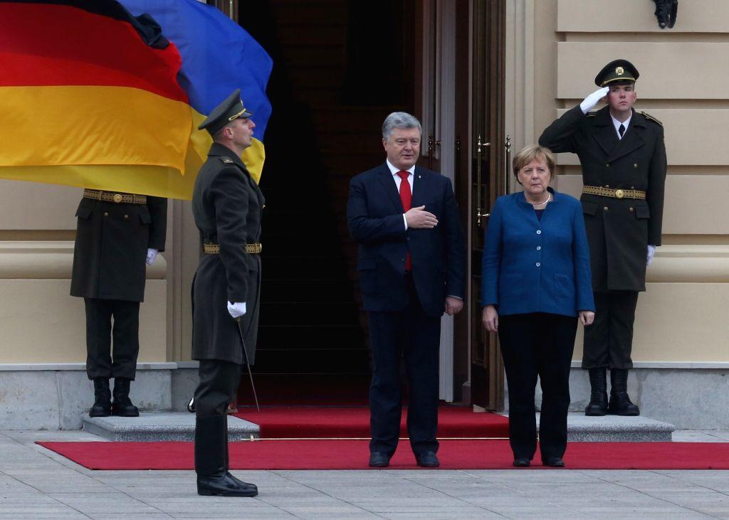 KIEV, Nov. 2, 2018 - Ukrainian President Petro Poroshenko welcomes visiting German Chancellor Angela Merkel (2nd R) during a ceremony in Kiev, Ukraine, Nov. 1, 2018. Ukrainian President Petro ...