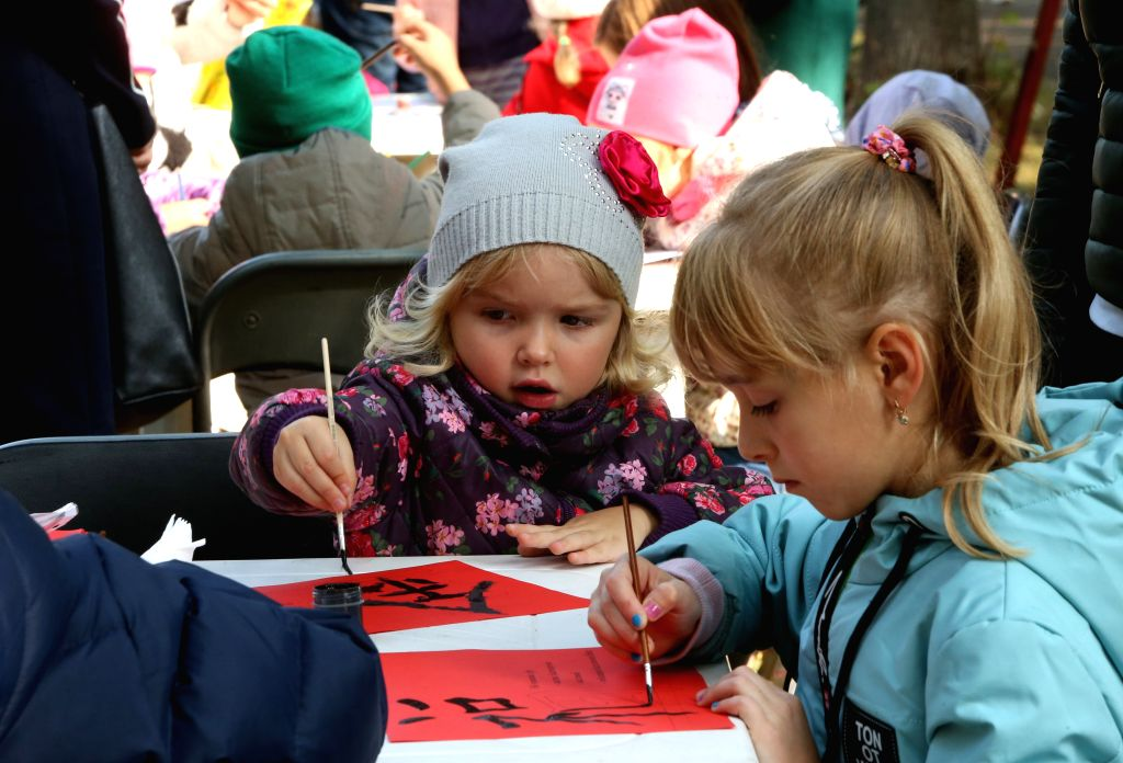 "KIEV, Sept. 28, 2019 - Children try to write Chinese characters during a cultural event in Kiev, Ukraine, on Sept. 28, 2019. A cultural event entitled ""Unusual Journey to China,"" which was ..."