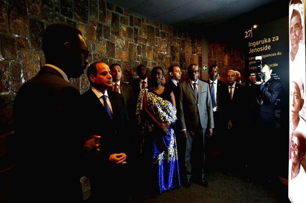 KIGALI, Aug. 15, 2017 - Egyptian President Abdel-Fattah al-Sisi (2nd L) visits Kigali Genocide Memorial in Kigali, capital of Rwanda, on Aug. 15, 2017. Egyptian President Abdel-Fattah al-Sisi on ...