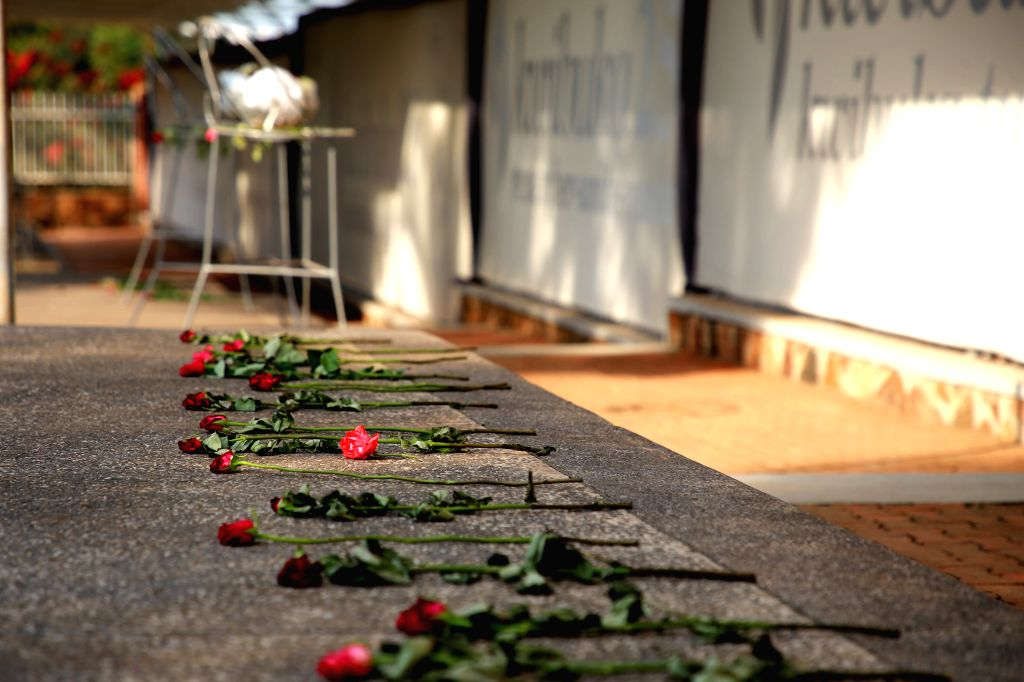 KIGALI, Aug. 25, 2019 - Flowers are laid on the ground at the Kigali Genocide Memorial in Kigali, capital of Rwanda, on Aug. 13, 2019. In recent two decades, Rwanda has registered remarkable progress ...