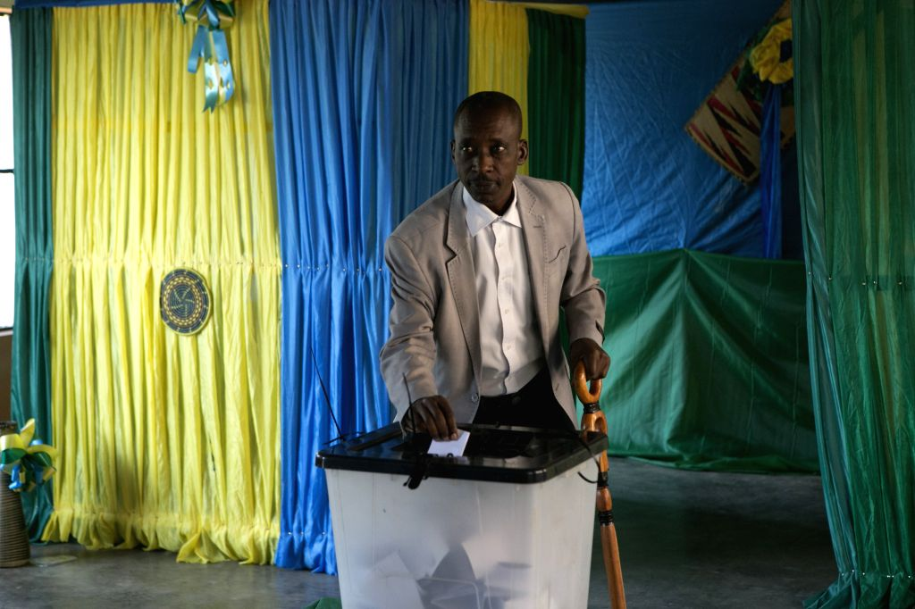 KIGALI, Aug. 4, 2017 - A voter casts his ballot in presidential elections in Kigali, capital city of Rwanda, on Aug. 4, 2017. Rwandan presidential elections kicked off Friday. Analysts expect ...