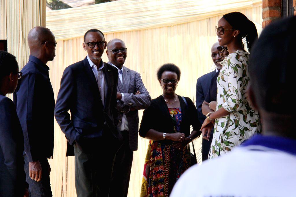 KIGALI, Aug. 4, 2017 - Rwandan presidential candidate and incumbent President Paul Kagame (2nd L) chats before casting vote in Kigali, capital city of Rwanda, on Aug. 4, 2017. Rwandan presidential ...