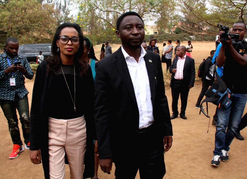 KIGALI, Aug. 4, 2017 - Rwandan presidential candidate Frank Habineza (R, front) of the Democratic Green Party of Rwanda arrives at a polling station in Kigali, capital city of Rwanda, on Aug. 4, ...