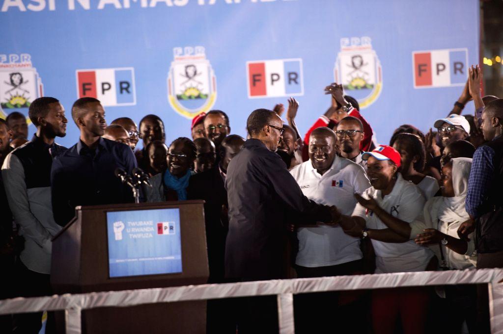 KIGALI, Aug. 5, 2017 - Rwandan presidential candidate, the incumbent President Paul Kagame (C, Front), greets supporters in Kigali, capital of Rwanda, on Aug. 5, 2017. The Rwandan National Electoral ...