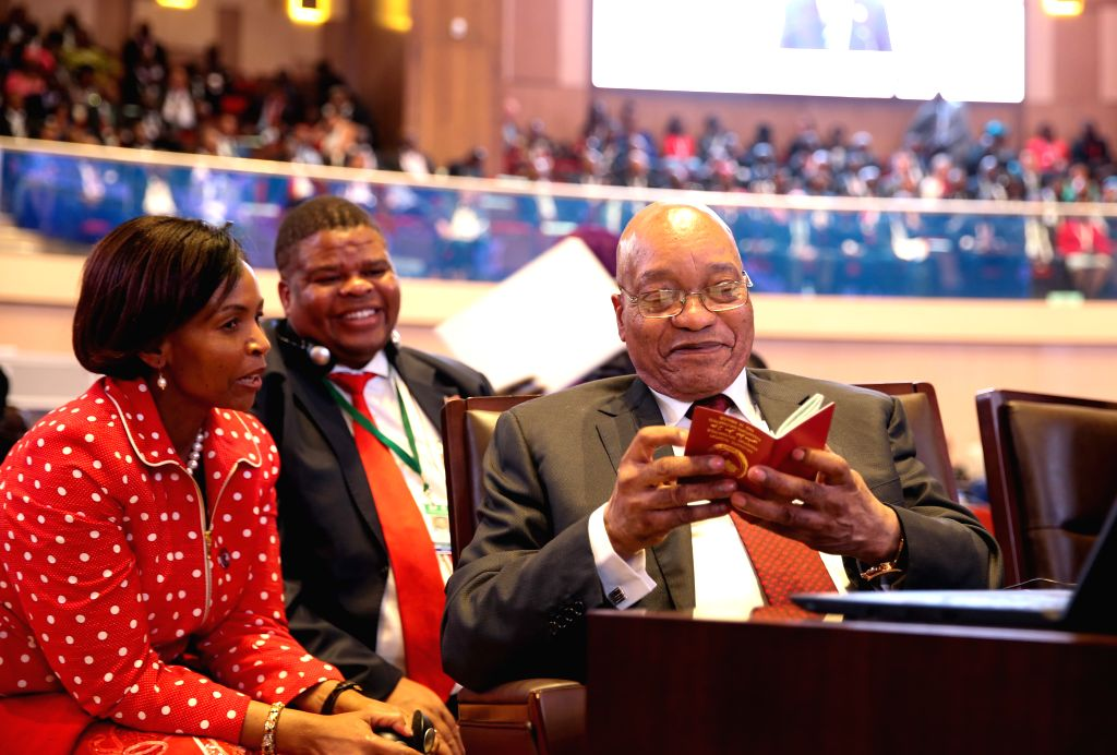 KIGALI, July 17, 2016 - South African President Zuma (R) reads an e-passport at the opening ceremony of the 27th ordinary session of the AU Heads of States, in Kigali, Rwanda, July 17, 2016.  African ...