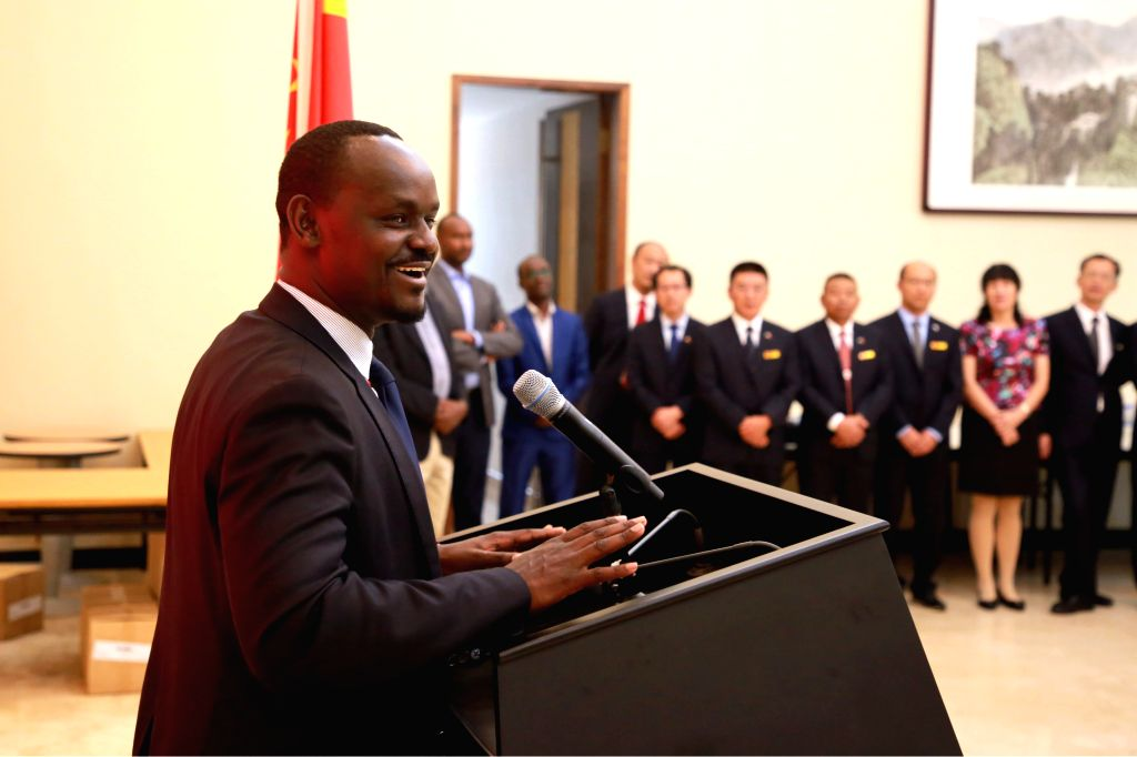 KIGALI, Oct. 15, 2019 - Permanent Secretary of Rwanda's Ministry of Health Jean Pierre Nyemazi speaks during a handover ceremony between the 19th and 20th Chinese medical teams at the Chinese embassy ...