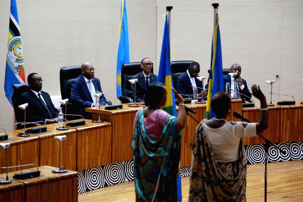 KIGALI, Oct. 17, 2019 - Newly-elected vice-presidents of Senate take an oath of office before Rwanda's President Paul Kagame (C, rear) in Kigali, Rwanda, on Oct. 17, 2019. Rwanda's Senate on Thursday ...