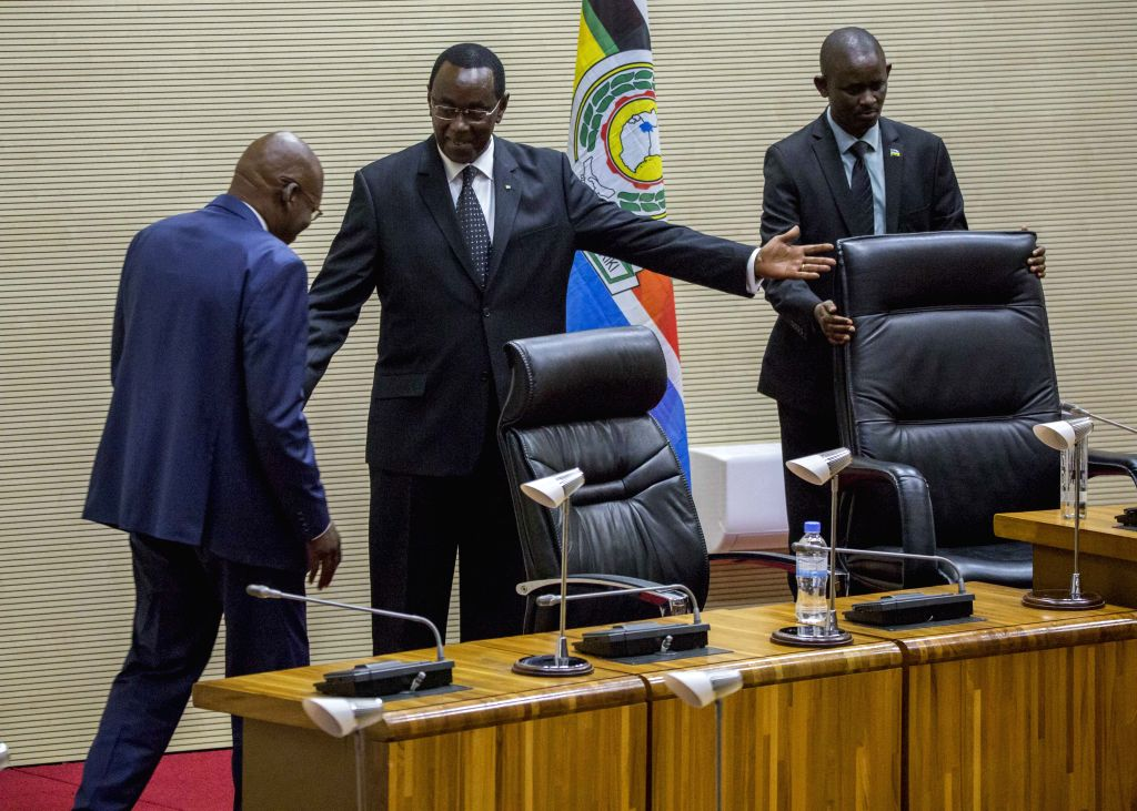 KIGALI, Oct. 17, 2019 - Outgoing Senate president Bernard Makuza (C) ushers newly-elected Senate president Augustin Iyamuremye to the seat in Kigali, Rwanda, on Oct. 17, 2019. Rwanda's Senate on ...