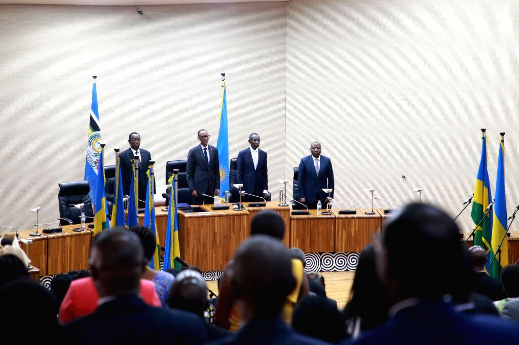KIGALI, Oct. 17, 2019 - Rwanda's President Paul Kagame (2nd L), outgoing Senate president Bernard Makuza (1st L), Chief Justice Sam Rugege (2nd R) and Prime Minister Edouard Ngirente (1st R) attend a ... - Edouard Ngirente