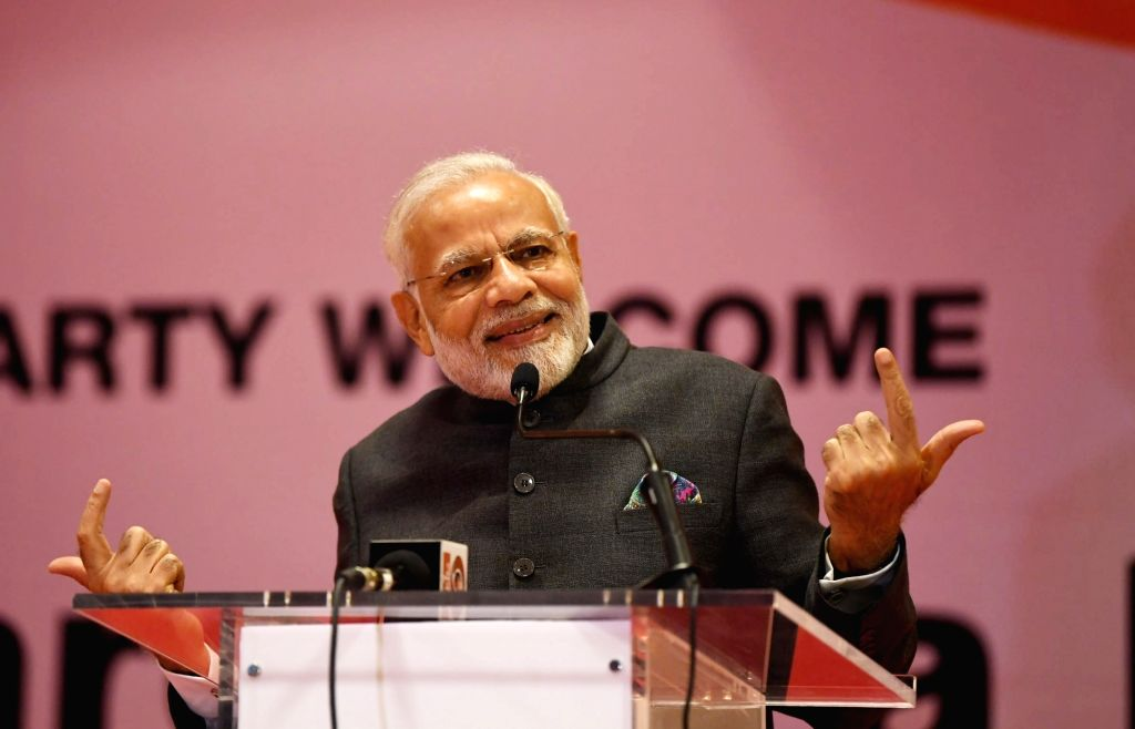 :Kigali: Prime Minister Narendra Modi addresses at a ceremonial reception accorded to him by the Indian Community, in Rwanda's Kigali on July 23, 2018. (Photo: IANS/MEA).