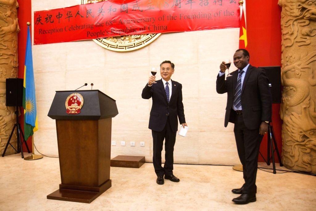 KIGALI, Sept. 28, 2017 - Chinese Ambassador to Rwanda Rao Hongwei (L) and Rwandan Minister of State in Charge of Economic Planning Uzziel Ndagijimana propose a toast at a reception to celebrate the ... - Rao Hongwei