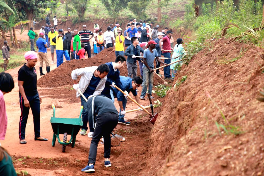 KIGALI, Sept. 28, 2019 - Chinese people and Rwandan residents work to renovate a road in the eastern suburb of Kigali, Rwanda, on Sept. 28, 2019. About 70 Chinese people, mainly from Chinese ...