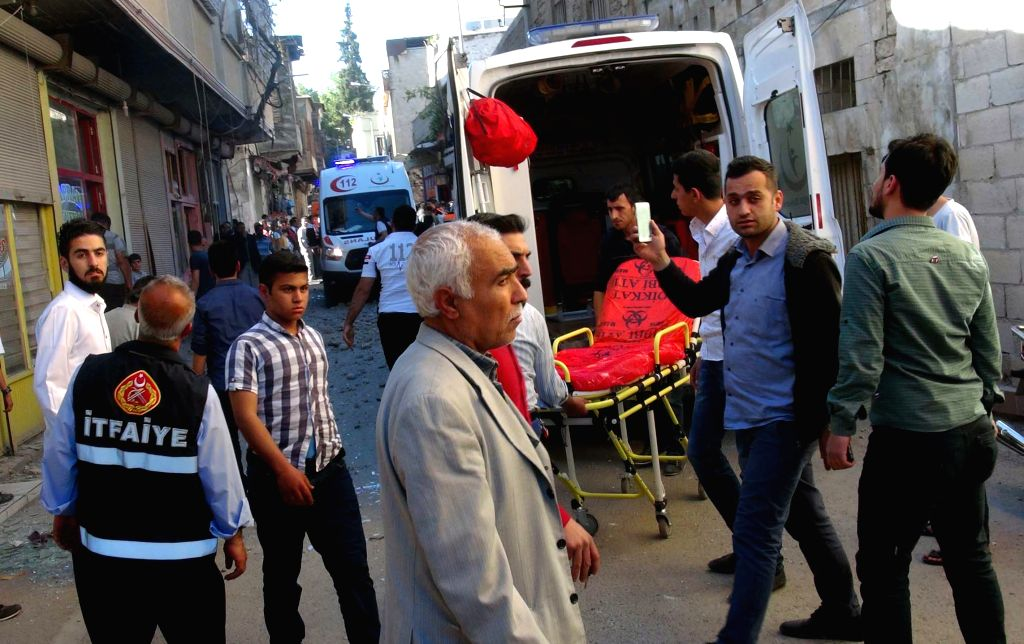 KILIS, April 18, 2016 - Ambulances arrive in the residential area after rockets launched from Syria hit the area in Turkish border province of Kilis on April 18, 2016. Four Syrians were killed after ...