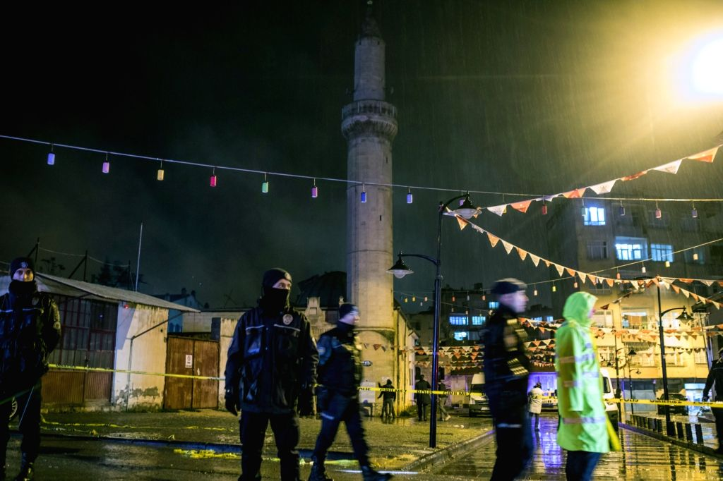 KILIS (TURKEY), Jan. 24, 2018 Police officers stand in front of a mosque which was hit by a rocket fired from Syria, in Kilis, Turkey, on Jan. 24, 2018. Two people were killed and 12 ...