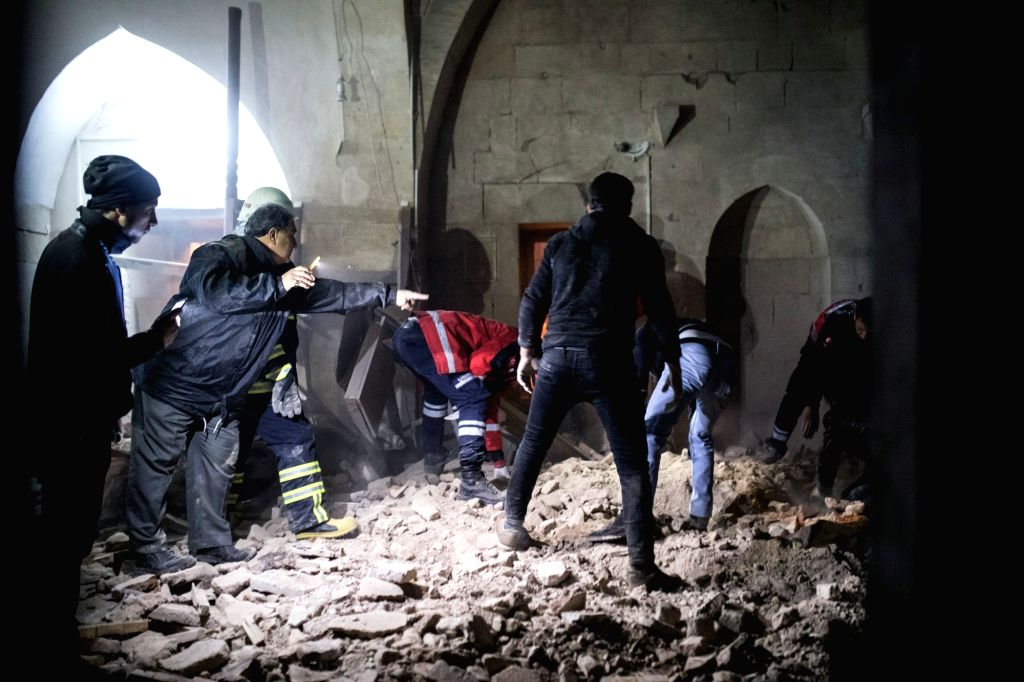 KILIS (TURKEY), Jan. 24, 2018 Rescuers clean up ruins in a mosque which was hit by a rocket fired from Syria, in Kilis, Turkey, on Jan. 24, 2018. Two people were killed and 12 others ...