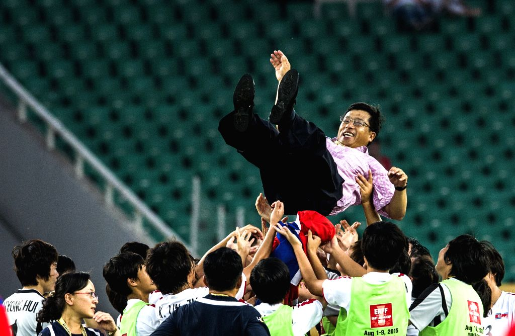 Kim Kwang Min, head coach of the Democratic People's Republic of Korea (DPRK), is thrown to the air for celebration after the match against South Korea at the 2015 ...