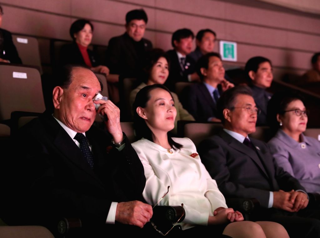Kim Yong-nam (far L), president of North Korea's Presidium of the Supreme People's Assembly, wipes away tears as he attends a concert, staged by the North's Samjiyon Orchestra, at the National ...